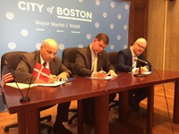 City Manager Louis A. DePasquale, Boston Mayor Martin J. Walsh, and Morten Kabell, Copenhagen Mayor of Technical and Environmental Affairs sign the Memorandum