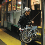 Person getting on the T with bike