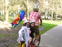 Children in Costume on Bikes