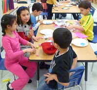 Children working on art project at Elm Street Community School