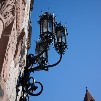 Decorative lamps on the side of a building