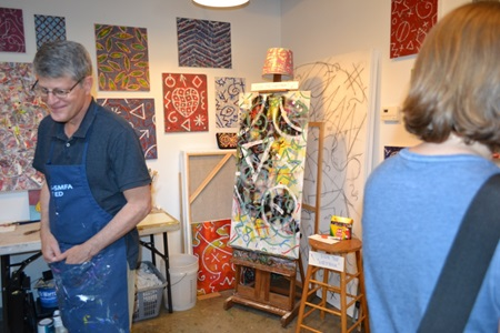 An artist and their studio on display during Cambridge Open Studios.