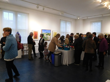 Attendees viewing art at the Cambridge Open Studios reception