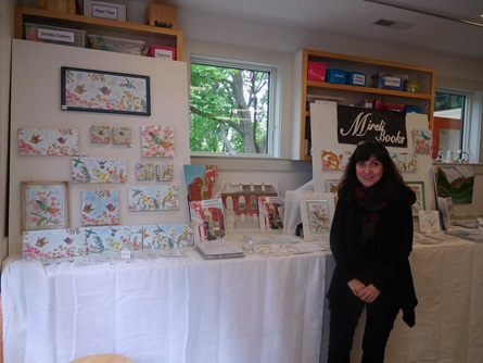 Cambridge Artist Mireli Books poses with her architectural coloring pages