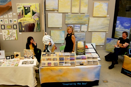 Artists Donna McNally and Hilary Tait Norod pose at their Cambridge Arts Open Studios booths