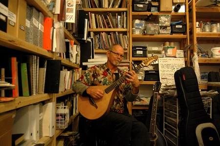 Performer Mitch Nelin plays the Mandocello at Open Studios