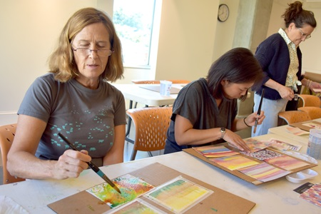 Participants in a free watercolor workshop led by Diane Charyk Norris at Lesley University's Lunder Art Center during the 2018 Cambridge Arts Open Studios.