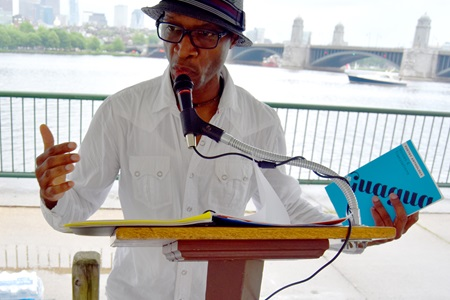 Jean Dany Joachim reads under the Poetry Tent at the 2018 River Festival.