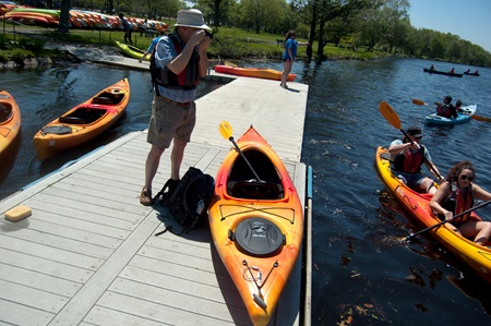 Richard Hackel gets ready to depart from the Charles River dock near the western end of the Cambridge shore.
