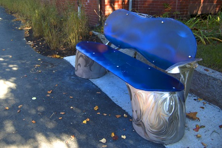 "A bench from Bland Hoke's ""Artesian Well – A Portal to Sacramento Park's Past"