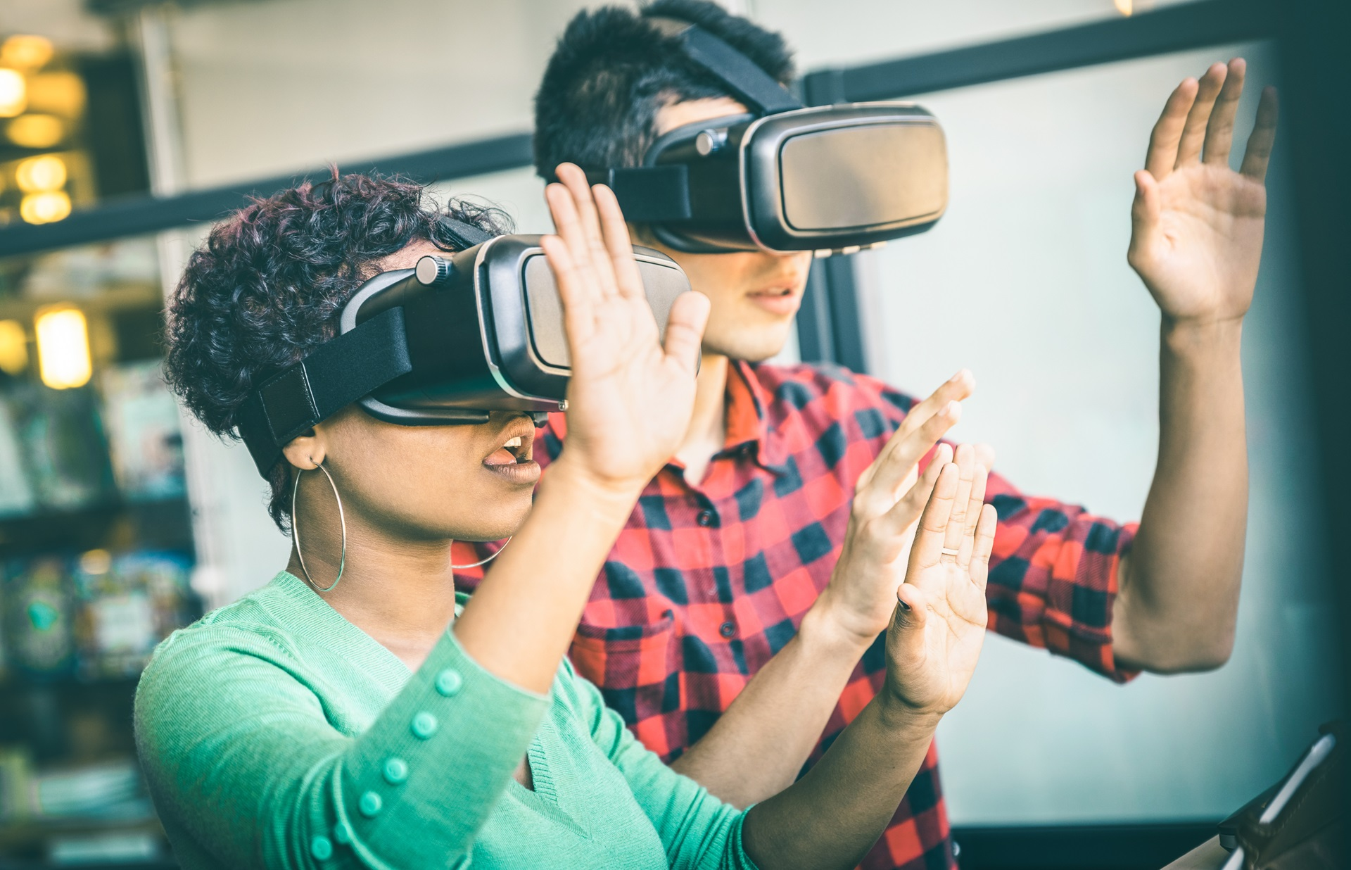 Photo of two people wearing VR headsets