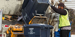 Photo of recycling bin being emptied into recycling truck