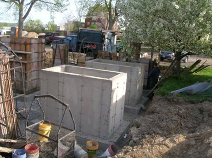 The concrete base for the elevated garden beds during construction.