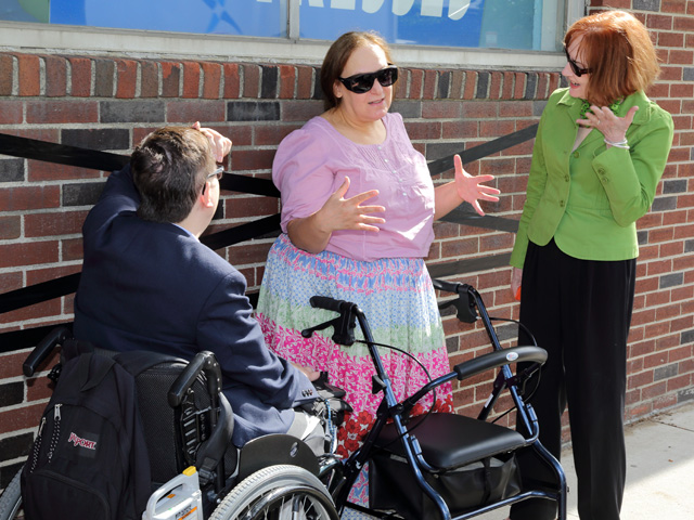 Sidewalk conversation with disabled person