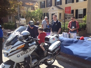 Kids on police motorcycle in Harvard Square