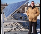 Paul Lyle on Frazier Building roof with PV panels
