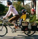 Mother and two children enjoying a bike ride
