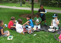 kids having lunch in park