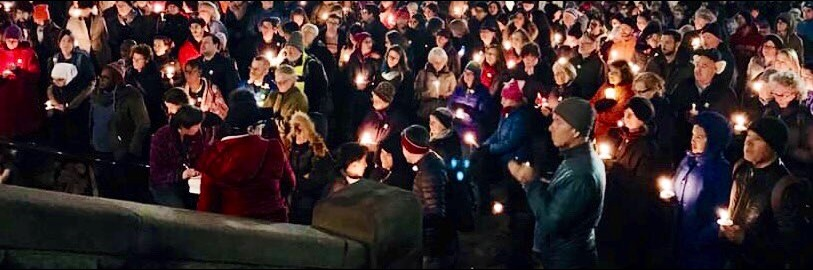 People gathered in front of Cambridge City Hall for a candlelight vigil