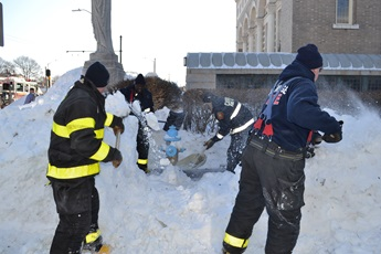 firefighters shoveling out hydrants