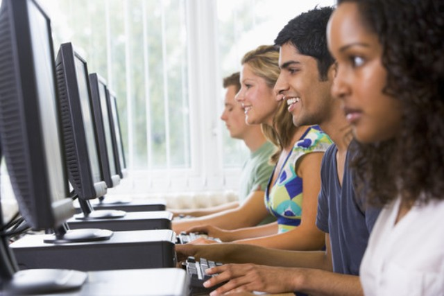 Image of people getting computer training