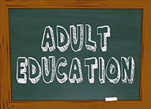 """adult education"" written on a blackboard"