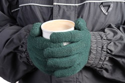 Gloved Hands holding Hot Coffee