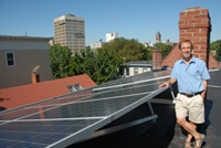 David Neiman with solar panels