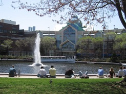 People sitting on grass at Lechmere Canal