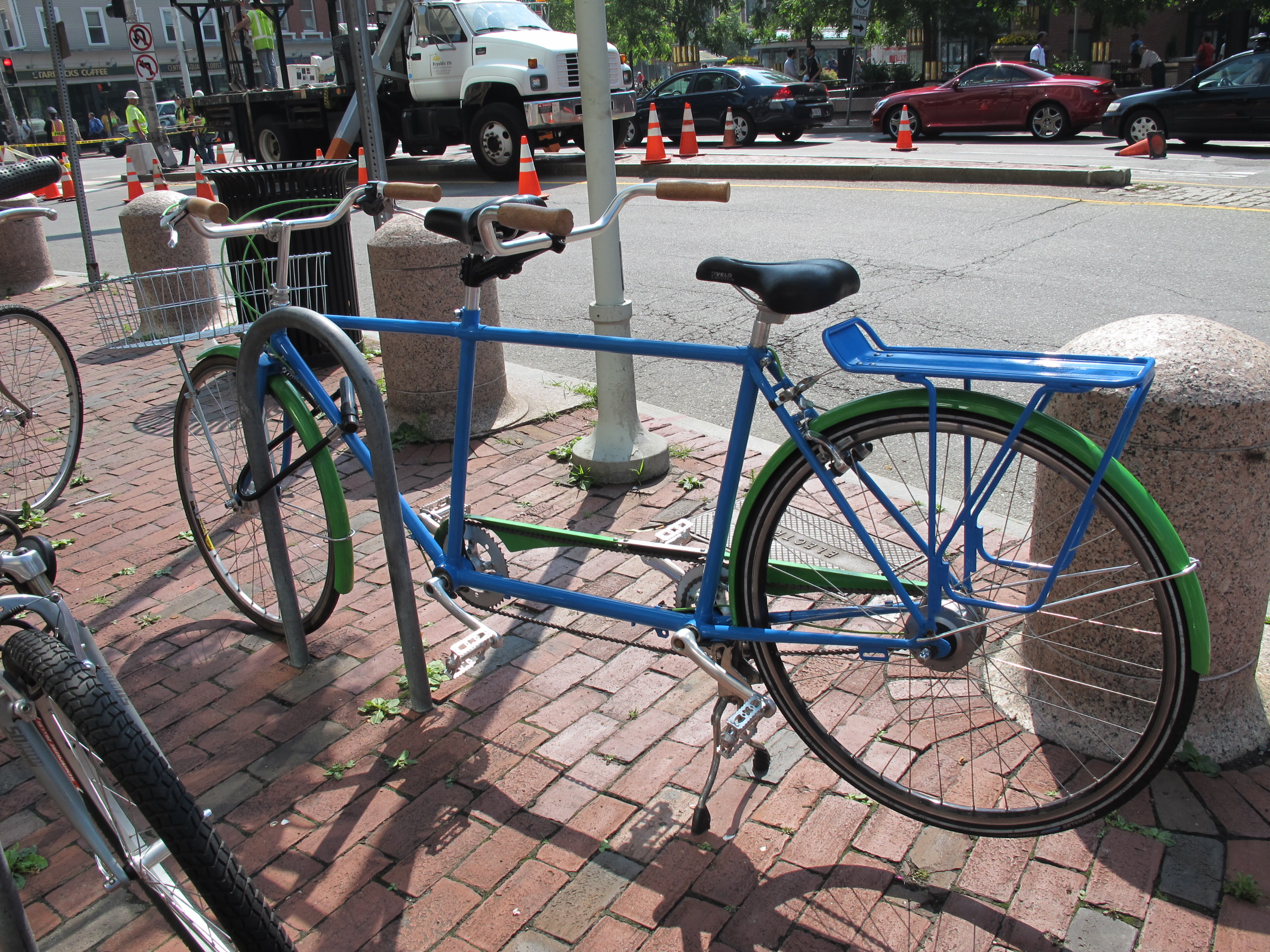 tandem bicycle locked to bike rack