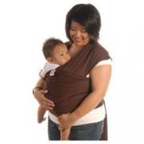 A mother with her baby in a wrap-style carrier