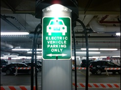 Green electric vehicle parking only sign in Boston Properties' West Garage