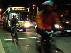 Bikes and bus on roadway together