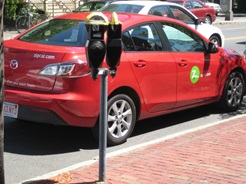 Red Zipcar parked at a meter in Cambridge, MA
