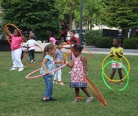 kids playing hula hoop in the park