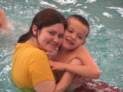 Mother and son in a pool