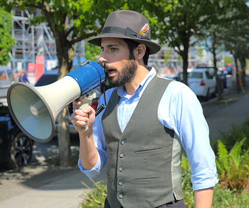 Artist Carmen Papalia speaks into a bullhorn.