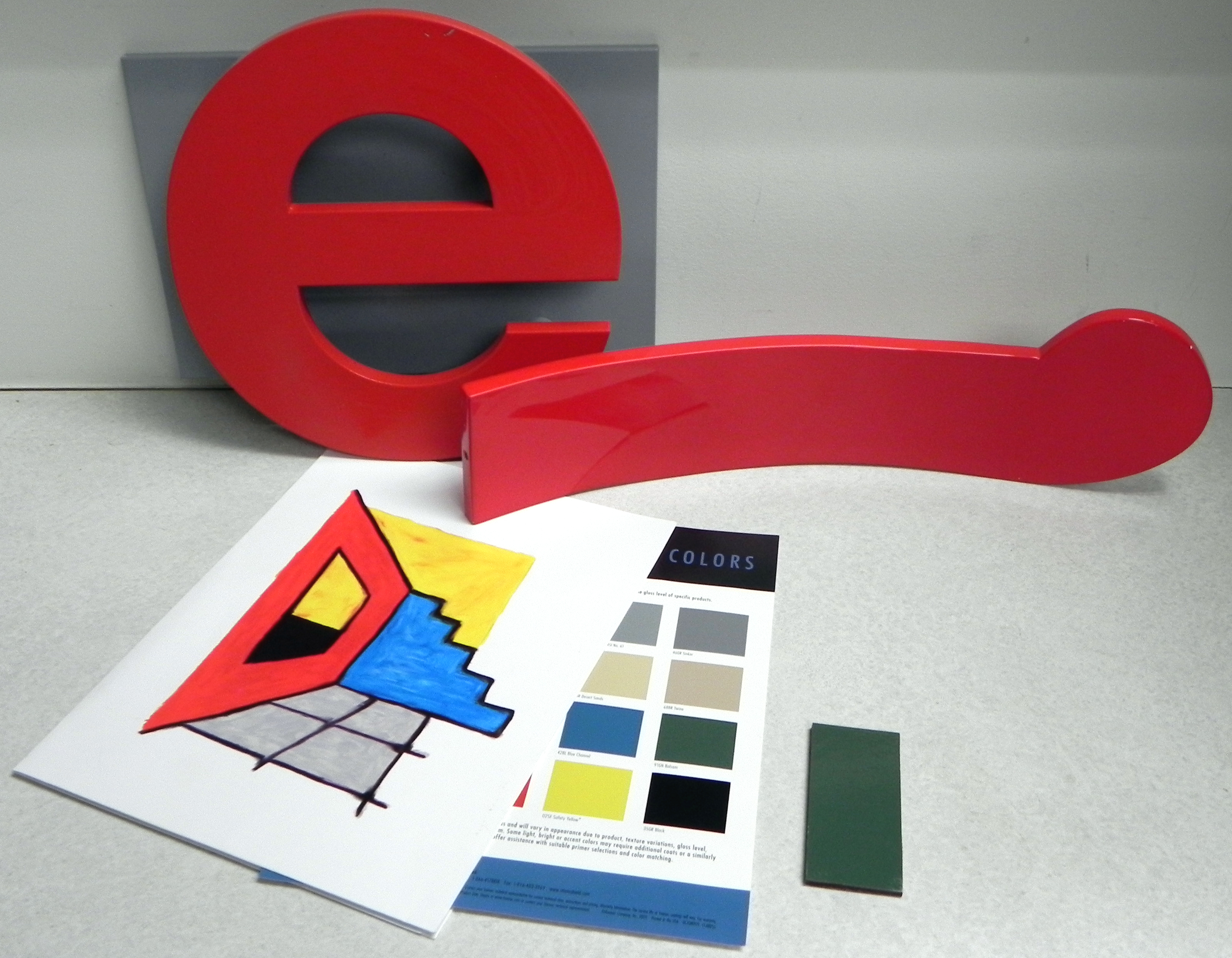Photograph of paint systems and color samples for outdoor public artwork.