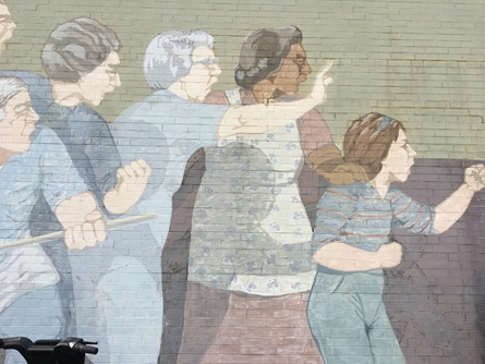 Detail of protesters in Bernard Lacasse's Beat the Belt Mural