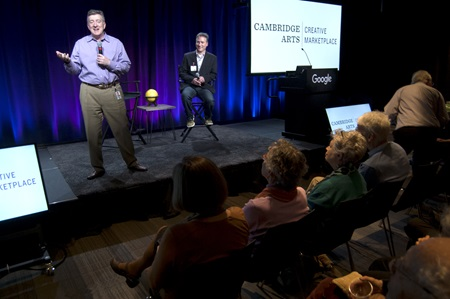Google Industry Director Brian Cusack (left) and Cambridge Arts Executive Director Jason Weeks speak about fostering innovation in technology and the arts at the Community Supported Art Harvest Party at Google Cambridge, Nov. 1, 2017.