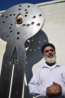 Mahmood Rezaei-Kamalabad, a Cambridge artist and owner of Aladdin Auto Body, poses in front of one of his steel sculptures during Cambridge Open Studios.