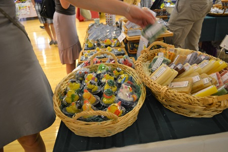 Baskets hold artist made soaps at Cambridge Open Studios.