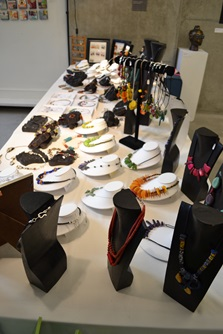 A table of artist made jewelry at a venue during Cambridge Open Studios.