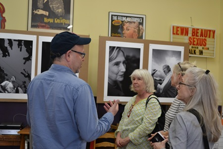 An artist speaks with attendees during Cambridge Open Studios.