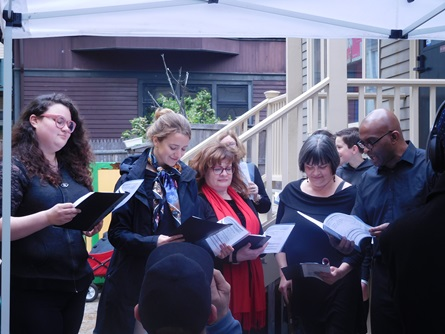 A group of individuals singing in a chorus at Cambridge Arts Open Studios