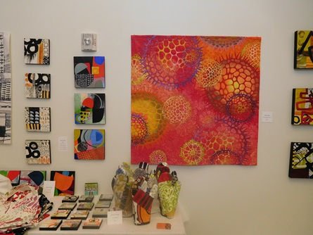 A grouping of colorful paintings by a Cambridge Arts Open Studios artist