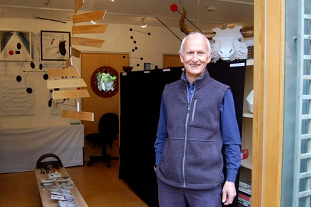 Artist Hubert Murray stands in the doorway of his studio