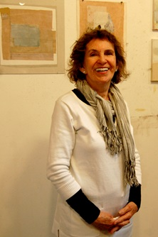 Artist Nina Pattek poses in front of some of her work