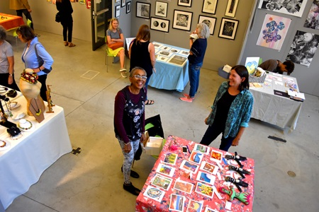 Camille Musser (left) and Diane Charyk Norris at the Lunder Arts Center at Lesley University during the 2018 Cambridge Arts Open Studios.