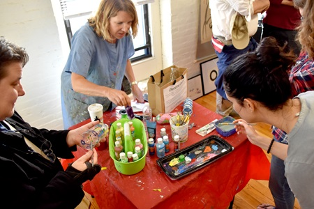 Robyn Hale Reed (center) leads an art making workshop about the plastics polluting the world's oceans at Industry Lab during the 2018 Cambridge Arts Open Studios.
